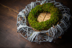Moss and wooden wreaths. Moss and wood handmade wreaths with copy space for text Stock Image