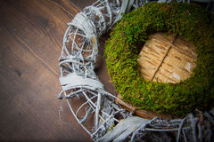 Moss and wooden wreaths. Moss and wood handmade wreaths with copy space for text Royalty Free Stock Photography