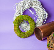 Moss and wooden wreaths. Moss and wood handmade wreaths with copy space for text Royalty Free Stock Photo