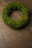 Moss and wooden wreaths. Moss and wood handmade wreaths with copy space for text Royalty Free Stock Image