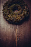 Moss and wooden wreaths. Moss and wood handmade wreaths with copy space for text Stock Photo