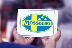 Mossberg firearms manufacturer logo. Logo of Mossberg company on samsung tablet. Mossberg is an American firearms manufacturer, specializing in shotguns, rifles Royalty Free Stock Photos