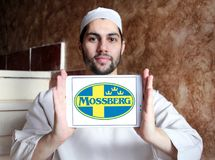 Mossberg firearms manufacturer logo. Logo of Mossberg company on samsung tablet holded by arab muslim man. Mossberg is an American firearms manufacturer Royalty Free Stock Photography