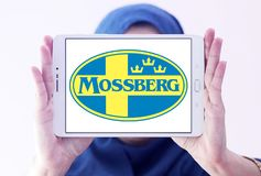 Mossberg firearms manufacturer logo. Logo of Mossberg company on samsung tablet holded by arab muslim woman. Mossberg is an American firearms manufacturer Stock Images