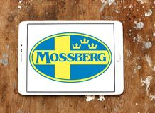 Mossberg firearms manufacturer logo. Logo of Mossberg company on samsung tablet. Mossberg is an American firearms manufacturer, specializing in shotguns, rifles Royalty Free Stock Photography