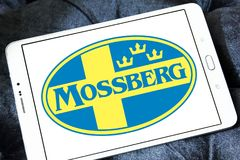 Mossberg firearms manufacturer logo. Logo of Mossberg company on samsung tablet. Mossberg is an American firearms manufacturer, specializing in shotguns, rifles Stock Photos