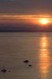 Mosselbay Sunrise. Early monring sunrise over Mosselbay with a few yachts anchored Royalty Free Stock Photography