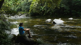 Mossman gorge and tourist Stock Image