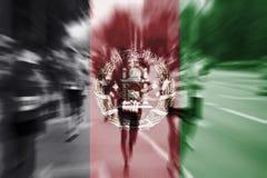Mosso del corridore maratona con il mescolamento della bandiera di Afghanistan Fotografia Stock Libera da Diritti