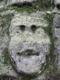 Mossy Bizarre Stone Heads - Rock Sculptures Royalty Free Stock Images