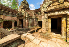 Mossy buildings with carving of ancient Preah Khan, Angkor Stock Images