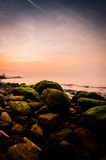 Mossy Rocks On Shoreline In Sunset Royalty Free Stock Images