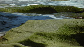 Mossy rocks and water. Mossy rocks with water Stock Photography