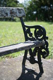 Mossy Victorian Park Bench royalty free stock photos