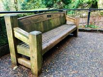 Mossy wooden bench. At multnomah falls Royalty Free Stock Photo