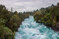 Huka falls. The most amazing falls in north island of new zealand,the ice blue water and the river like a jade belt Royalty Free Stock Photography