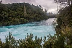 Huka falls. The most amazing falls in north island of new zealand,the ice blue water and the river like a jade belt Royalty Free Stock Image