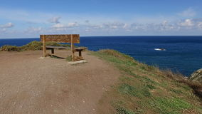 The most beautiful bank in the world on the highest cliffs 01. A humble bench overlooking the highest cliffs in Europe tracking in stock footage