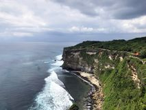 The most beautiful cape Uluwatu in Bali overlooking the ocean stock photos