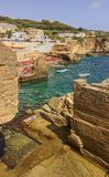The most beautiful coasts of Italy:Salento seascape Apulia. Rocky beach of Santa Cesarea Terme. It`s lapped by the sea, with deep water along the whole coast stock photography