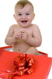The most beautiful gift. Baby in the present box laughing royalty free stock image