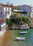 The most beautiful lagoon and white houses on the rocky peninsula in the Skiathos Town Stock Images