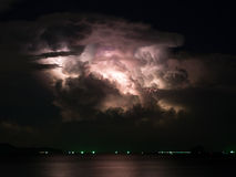 Most cloudy with lightning storm inside on the sea Stock Photos