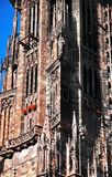 Breathtaking details of Freiburger Minster Cathedral tower, Freiburg im Breisgau, Germany royalty free stock photo