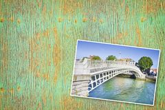 The most famous bridge in Dublin called `Half penny bridge` due to the toll charged for the passage - Concept image with copy spac. E on wooden background royalty free stock images