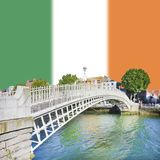The most famous bridge in Dublin called `Half penny bridge` on Irish flag background - concept image with copy space.  royalty free stock photos