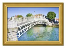 The most famous bridge in Dublin called `Half penny bridge` due to the toll charged for the passage - Wooden golden frame concep. T royalty free stock photos