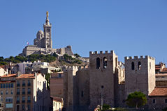The most famous cathedrals of Marseille. Basilica Notre-Dame de la Garde and Cathedral Abbey of Saint Victor Stock Photos
