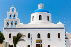 The most famous church on Santorini Island,Crete, Greece. Bell tower and cupolas of classical orthodox Greek church Royalty Free Stock Image