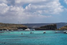 Comino Island, Malta Pleasure boats moored at the Blue Lagoon. The most famous and crowded beach in Malta with crystal clear waters Royalty Free Stock Photos
