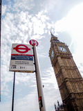 The most famous London landmark Big Ben with the unique London underground sign. LONDON, UNITED KINGDOM - APRIL 16, 2015: The most famous London landmark Big Ben Royalty Free Stock Images