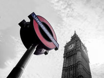 The most famous London landmark Big Ben with the unique London underground sign. LONDON, UNITED KINGDOM - APRIL 16, 2015: The most famous London landmark Big Ben Royalty Free Stock Photos