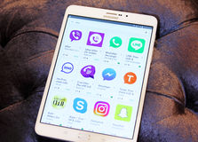 Most famous messenger applications on google play. List of top famous messenger applications on google play on samsung tab s2 like line, viber, skype,imo Stock Photo