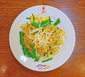 Most Famous Pad Thai Restaurant in Bangkok called Thip Samai as indicated on the plate itself. Customers usually queue until outside of the shop. This stock photo