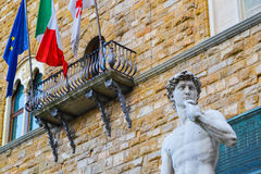 The most famous statue in Florence, David of Michelangelo, Italy. With italian european flags. No brexit. The most famous statue in Florence, David of Stock Photography