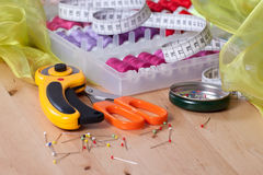 Sewing Accessories. Most frequently used sewing accessories on a wooden table stock photos