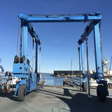 A big, beautiful blue specialized crane, for transporting sail boats on dry dock. Most industries have their own, specialized equipment, and sailing is no stock images