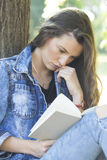 She most likes to read a book in nature Stock Image
