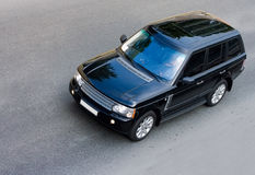 Most luxurious brand of british suv drive. On road isolated Royalty Free Stock Photography
