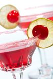 Most popular cocktails series. Closeup of two Cosmopolitan cocktails in martini glasses. Vodka, cranberry juice, triple sec liqueur, lime juice, garnished with Royalty Free Stock Image