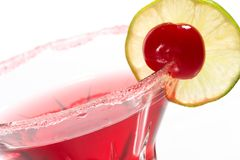 Most popular cocktails series. Closeup of Cosmopolitan cocktail in martini glass. Vodka, cranberry juice, triple sec liqueur, lime juice, garnished with lime and stock images