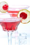 Most popular cocktails series. Closeup of two Cosmopolitan cocktails in martini glasses. Vodka, cranberry juice, triple sec liqueur, lime juice, garnished with Stock Photo