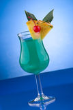 Most popular cocktails series - Blue Hawaiian. Blue Hawaiian cocktail. Rum, pineapple juice, coconut milk and blue curacao garnished with slice of pineapple and Stock Photo