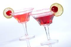 Most popular cocktails series - Cosmopolitan. Closeup of two Cosmopolitan cocktails in martini glasses. Vodka, cranberry juice, triple sec liqueur, lime juice stock photography