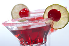Most popular cocktails series - Cosmopolitan. Closeup of two Cosmopolitan cocktails in martini glasses. Vodka, cranberry juice, triple sec liqueur, lime juice Stock Images