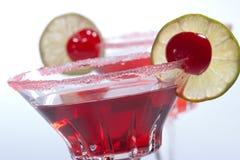 Most popular cocktails series - Cosmopolitan. Closeup of two Cosmopolitan cocktails in martini glasses. Vodka, cranberry juice, triple sec liqueur, lime juice stock images